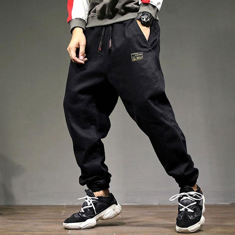 Compre Moda High Street Men Jogger Jeans Color Negro Suelta Fit Estilo  Punky Hip Hop Jeans Harem Pantalones Cintura Elástica Cargo Pantalones  Hombres A ... 549ebf58be0
