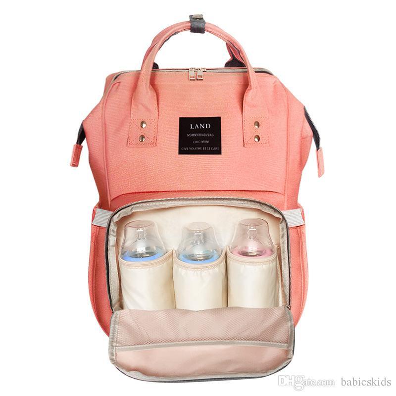 Nueva moda bolsa de pañales Momia Mochila para padres modernos Gran capacidad de almacenamiento de múltiples funciones Bolsa de bebé Tela impermeable para el cuidado del bebé
