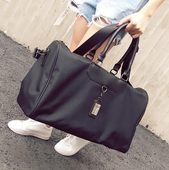 d5c14bc58235 2019 2018 Gym Bags Famous Brand Large Capacity Folding Portable Men Women  Sports Bag Waterproof Solid Duffle Bag Luggage Handbag From Pineappleg