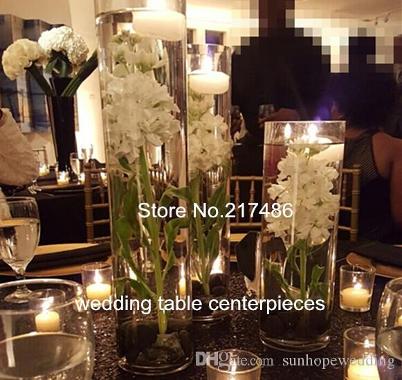 clear acrylic vases with candles that can float.also small candle holders