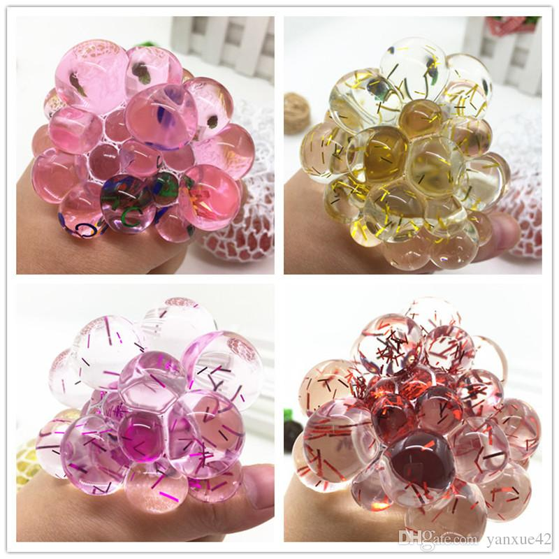 New children's new exotic gold sequins extrusion fruit grape ball vent decompression toys
