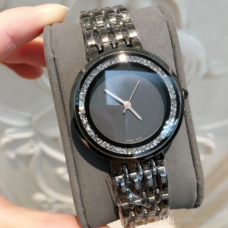 5277ab0135e Compre 2018 Marca De Luxo Novas Mulheres Relógio De Quartzo Moda Vestido De Diamante  Relógio De Pulso Reluzente Lazer Relógios De Aço Inoxidável Senhora ...