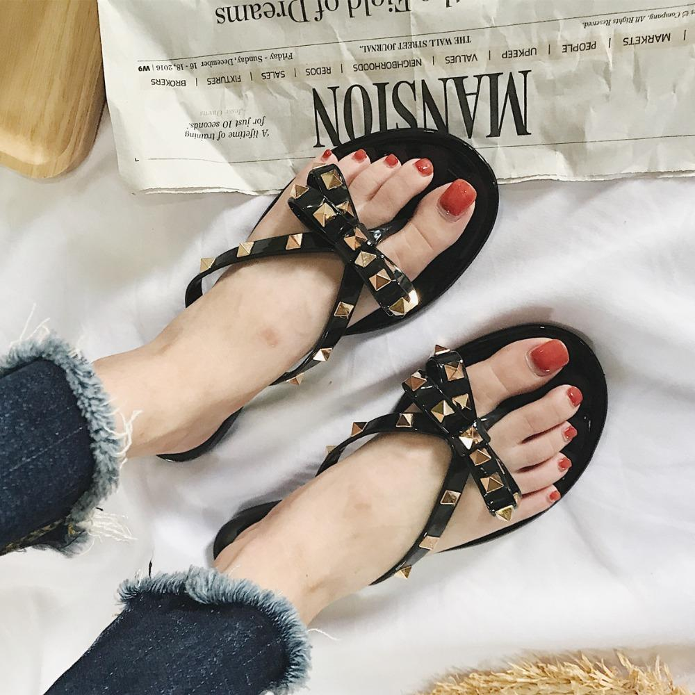 49ce616be12956 Fashion Rivet Bow Casual Women Slippers Summer Black Ladies Sandals Outside  Flat Beach Flip Flops Jelly Shoes Female 2018 NLD928 Black Boots Footwear  From ...
