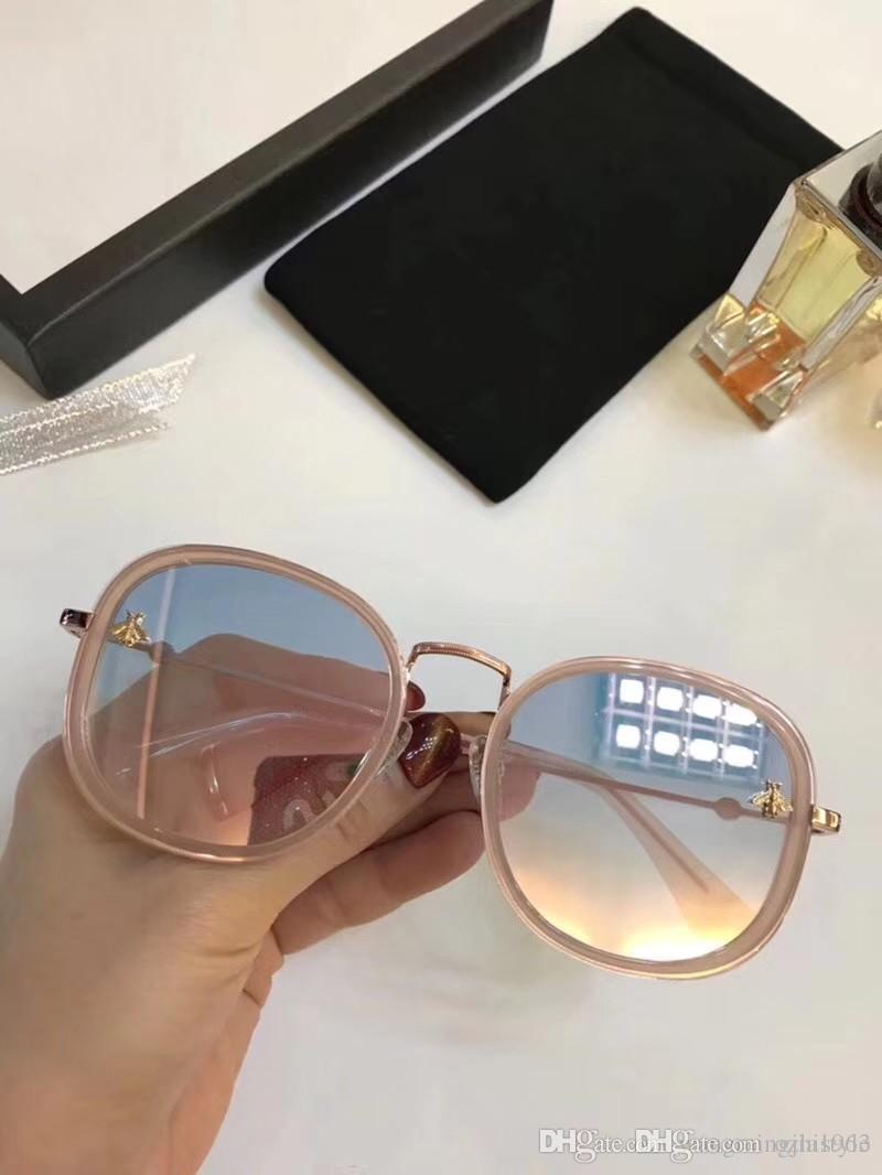6fbe159b65f21 Compre Gucci Alta Qualidade Homens E Mulheres Elegantes Óculos De Sol Marca  Mestre De Design Clássico E Moderno Combinação Perfeita Espelho Com Caixa  0238 ...