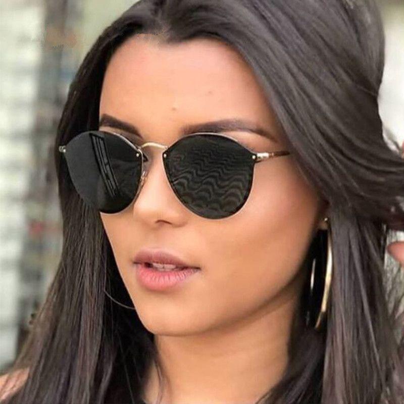 a8b85f7e75 Compre 2019 Nueva Moda Sin Montura Gafas De Sol Mujer Diseñador De La Marca  Espejo Redondo Del Ojo De Gato Gafas De Sol Mujer Dama Gafas De Sol Para  Las ...