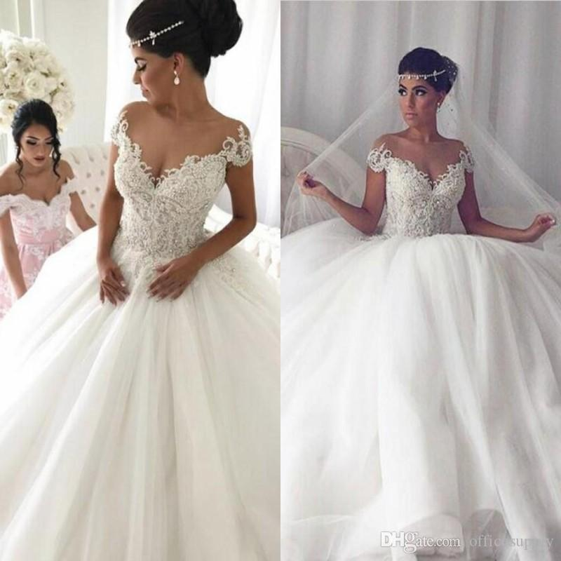 Elegant Sheer Jewel Neck Wedding Dresses With 3D Floral Bead Appliques Short  Sleeve Backless Church Bridal Gown Custom Made Dubai Style Ball Gown Wedding  ... 05e006c0878e