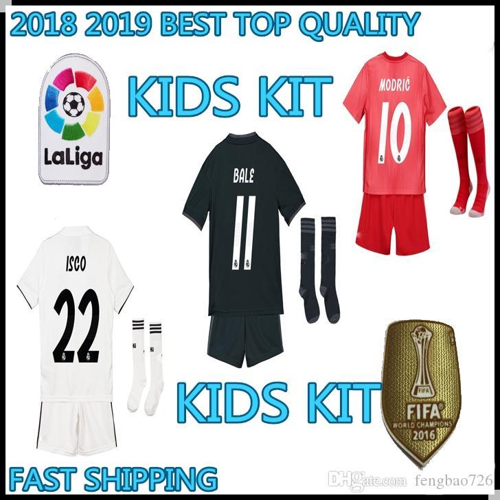abb68a5c2 Großhandel Kinder Kit Real Madrid 2018 2019 Fußball Jersey Weg Kroos Home  Weiß 2019 Boy Ramos Isco Modern 2019 Trikots Ninos 18 19 Uniform Von  Fengbao726