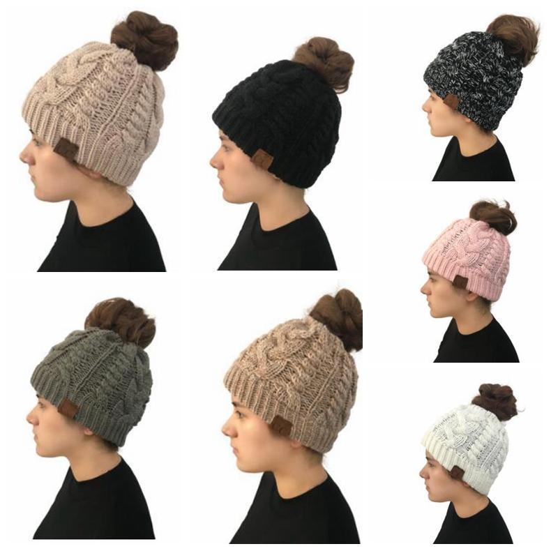 7bcc3b2ec92 2018 Trendy Cc Warm Winter Hat For Women Ponytail Beanie Stretch Cable Knit  Bun Soft Ski Cap Warm Skull Knitting Crochet HatsKka5901 From Best sports