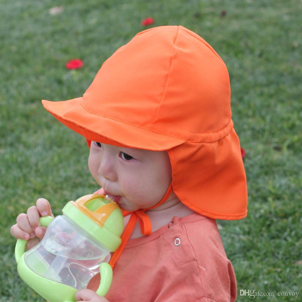 f3570be7e96 2019 Baby Summer Outdoor Sun Cap Floral Unisex Baby Kids Bucket Hat UV  Protection Hat Outdoor Soft Beach Hat Neck Ear Cover Flap Cap BH129 From  Convoy