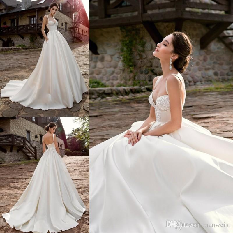 Discount Gorgeous 2019 Satin Beach Wedding Dresses With Pockets Sleeveless  Lace Appliques Country Bridal Gowns Spaghetti Strap Vestido De Novia  Designer ... 1f1582b4acbf