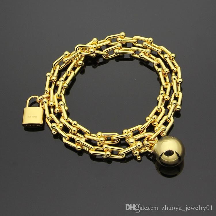 Commercio all'ingrosso di bracciale in titanio T acciaio caldo blocco a forma di U braccialetto a doppia lettera con bracciale in oro 18K Ms.