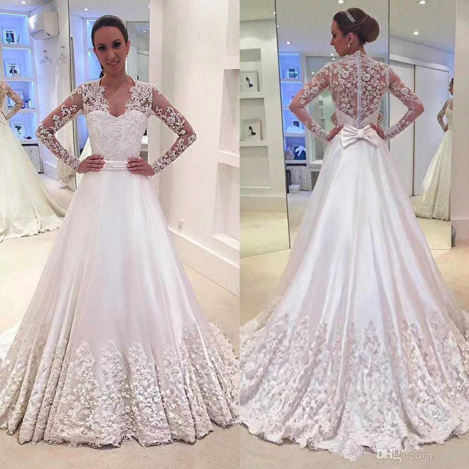 Long Sleeve Bride Dresses 2018 Vintage Stunning Train Bow 3D Floral Beaded Lace Stain Muslim Hijab Button Church Castle Wedding Dress