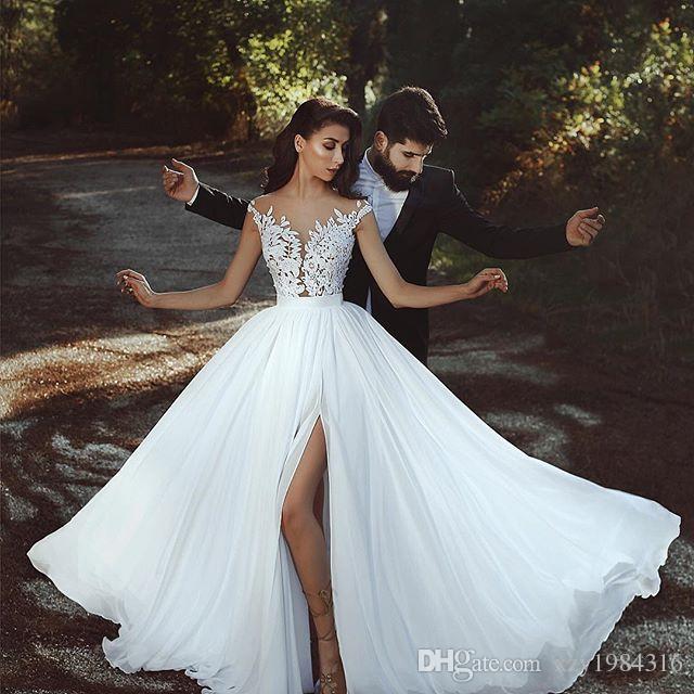 2018 Vestidos de novia sin espalda sexy Encaje Apliques Sheer Cuello sin mangas Vestido de novia con abertura lateral Glamorous Dubai gasa Vestidos de novia