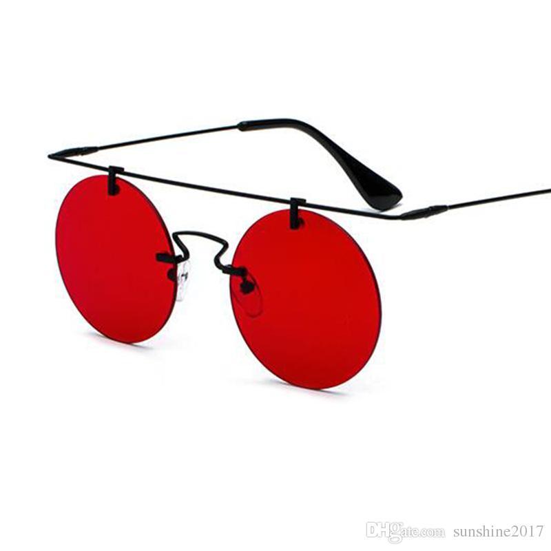 5dc6c830ec2df Compre Retro Lente Vermelha Rodada Óculos De Sol Sem Aro Designer Mulheres  De Luxo 2018 Círculo De Metal Ouro Óculos De Sol Dos Homens Rosa Azul  Espelho ...