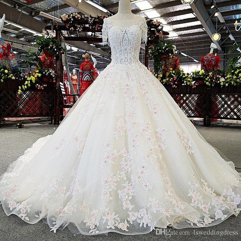 compre detalle de flores de color rosa claro vestido de novia de