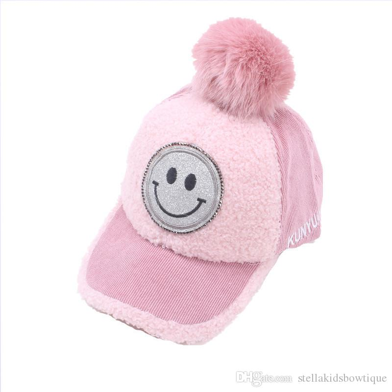 Best selling autumn and winter new 3-8 years old children smile face lambs fluffy ball 53-57 cap baby baseball cap wholesale
