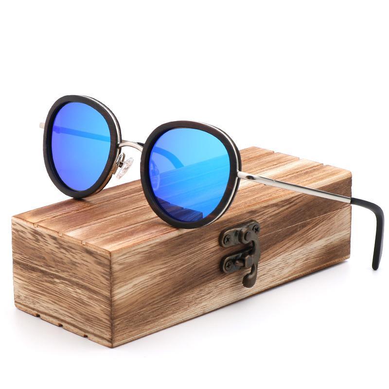 Compre Moda Polarizada Mulheres Rodada Óculos De Sol De Alta Qualidade  Feitos À Mão Óculos De Ébano Azul Lente Eyewear Caixa De Presente De  Madeira Gafas De ... 3ed9c5a13f