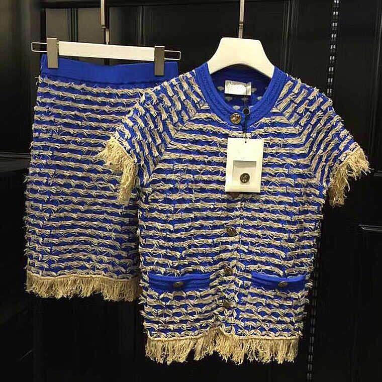 the latest 4b4b7 78669 abito blu e oro lavorato a maglia due gonne piecce