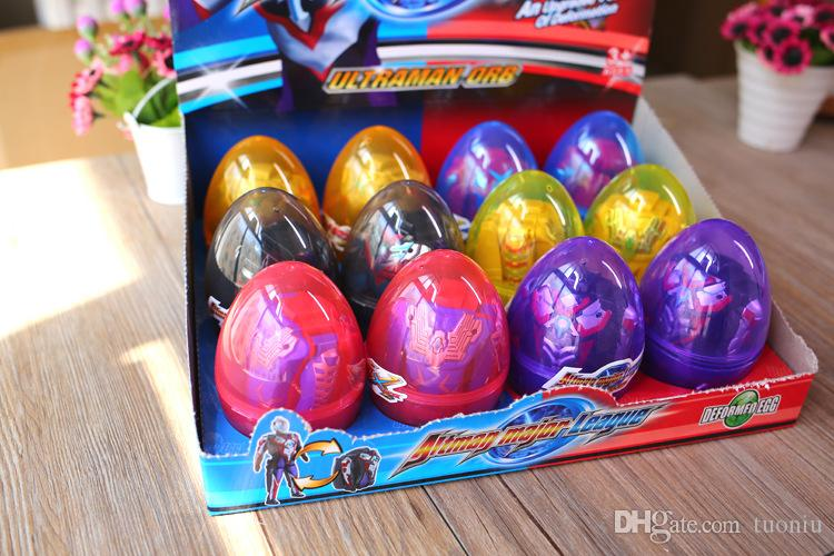 12PCS/ Lot Dinosaur World Dinosaur Egg Deformed Ultraman Funny Easter eggs Help children explore unknown toys Free Shipping