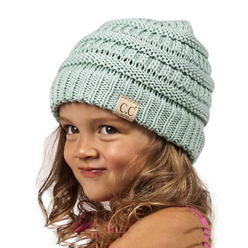 Kids CC Beanie 2 6 Years Old Solid Knitted Hats Children Hats For Girls  Cute Baby Boy Winter Cap Toddler Warm Skullies Beanies UK 2019 From  Kupaoliu 100eefb594a