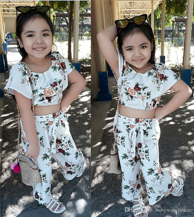 7b32b22a9bcd0 Summer Baby Girls Clothing Set Flower Print Off Shoulder Tops Pants 2PCS  Girls Outfits Cute White Floral Toddler Kids Clothing for Girls