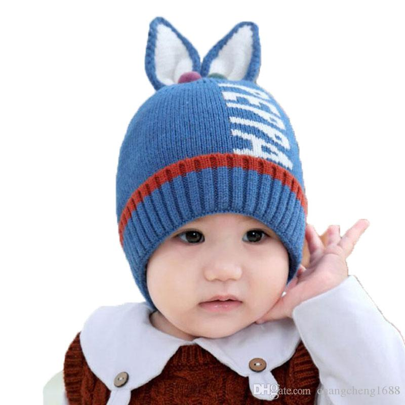 9e6c65756cb 2019 Kids Ribbed Knitted Beanies Hats Rabbit Ear Baby Cap Skullies Letter  Jacquard Skull Cap 2018 Winter Warm Child Hat Cap M6840 From  Changcheng1688