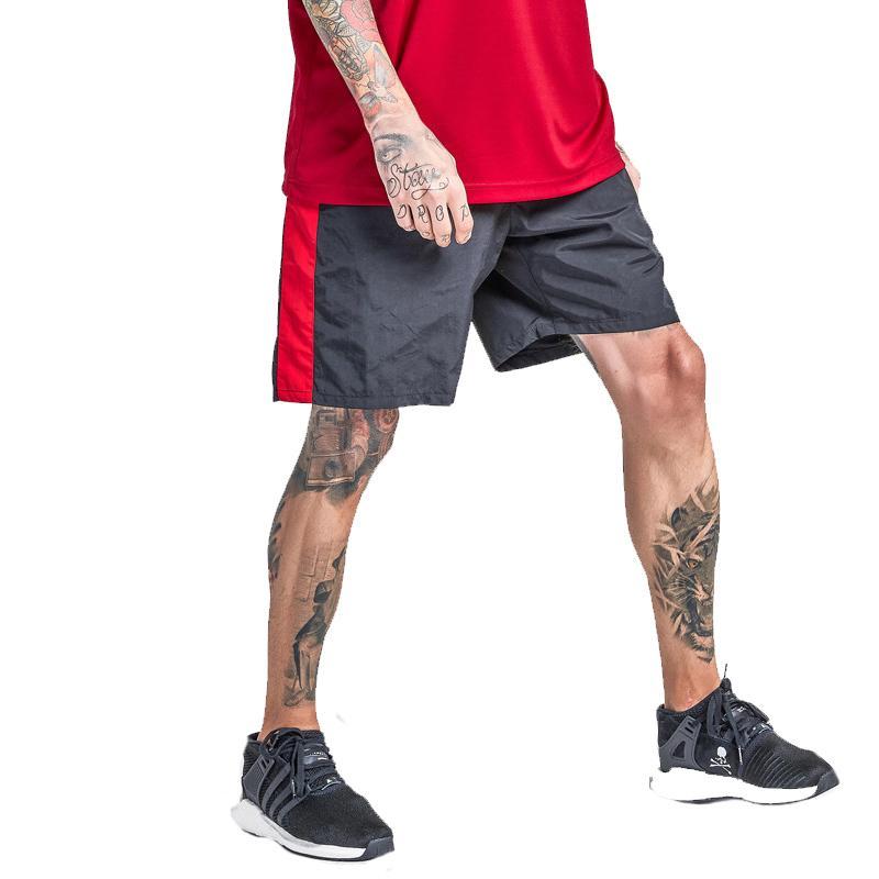 Compre Pantalones Cortos De Rayas Laterales Elásticos De Los Hombres De  Verano 2018 Pantalones Cortos De Basculador De Hombre Casual Ropa De Calle  ... 4e7e48dc078