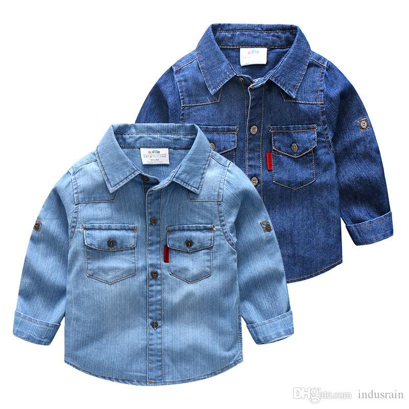 d88314ed9 Compre Bebé Algodón Camisa Jean Nueva Marca De Moda Ropa Para Niños Ropa  Casual Para Niños Vaqueros Camisas De Mezclilla Azul Para Niños Niñas  Blusas A ...