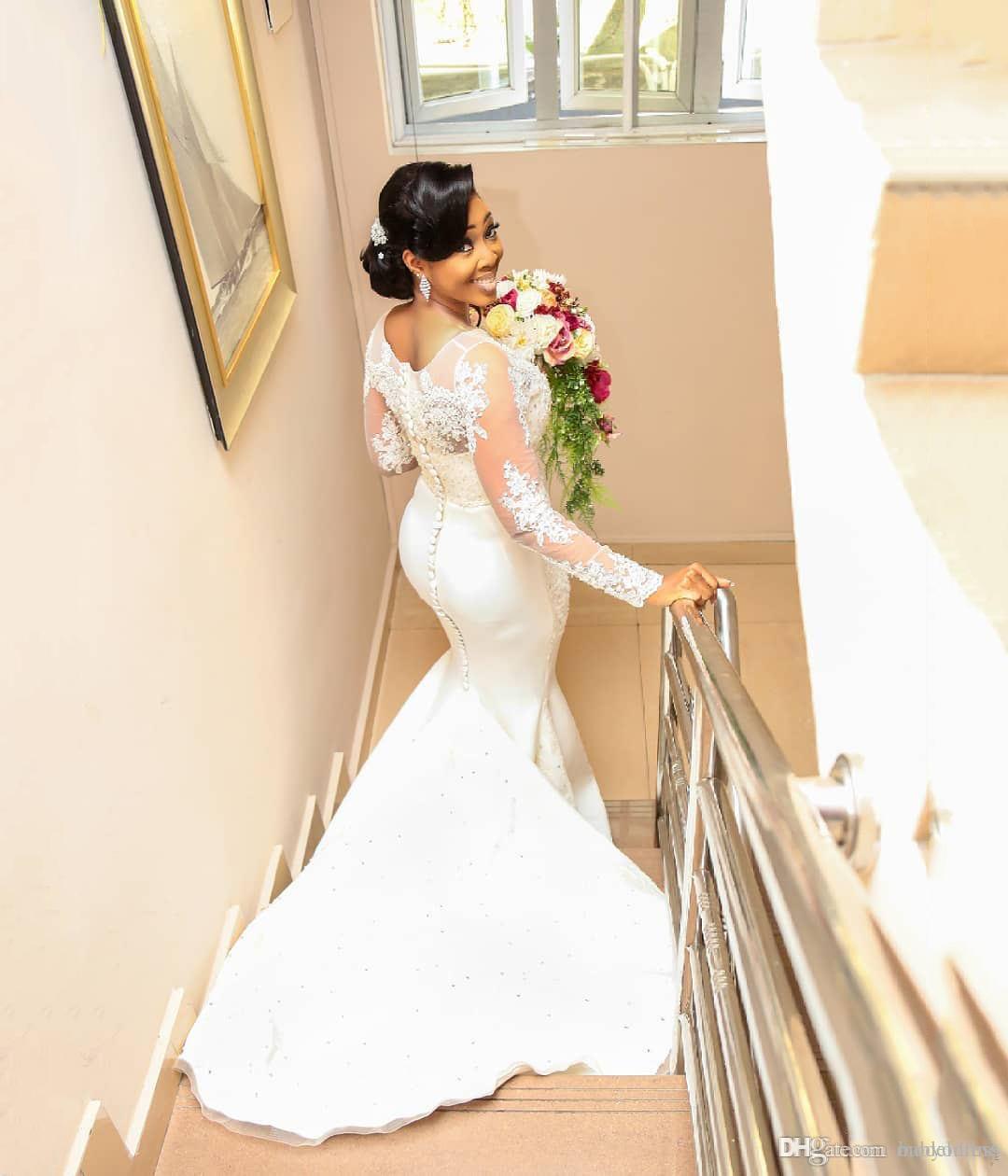 Abiti da sposa a sirena vintage in pizzo 2019 gioiello a maniche lunghe con applicazioni gioiello perline sweep treno abiti da sposa africani plus size su misura