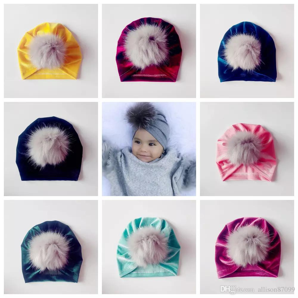 9ef7a0b372f 2019 2018 Baby Fall Winter Hats Wholesale Christmas Fur Pom Poms Hat  Pleuche Beanies Bonnet Girls Muslim Turban Skull Cap Accessories From  Allison87099