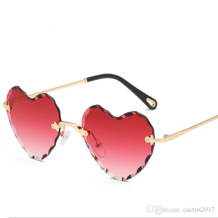 84ff188411 Compre Nuevo Amor En Forma De Corazón Gafas De Sol Para Mujer 2018 Montura  Sin Montura Tinte Lente Transparente Colorido Gafas De Sol Rojo Rosa  Amarillo ...