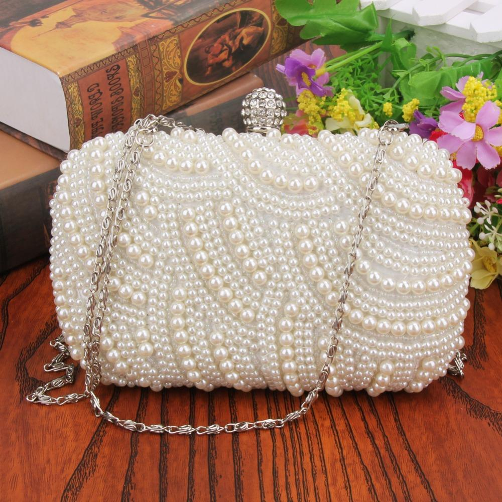 Oval Shaped Pearl Beaded Handbag Women White Clutch Bag Elegant Long Chain  Shoulder Handbags Wedding Bridal Purse Clutch Female Branded Handbags  Designer ... e913ba0defe2
