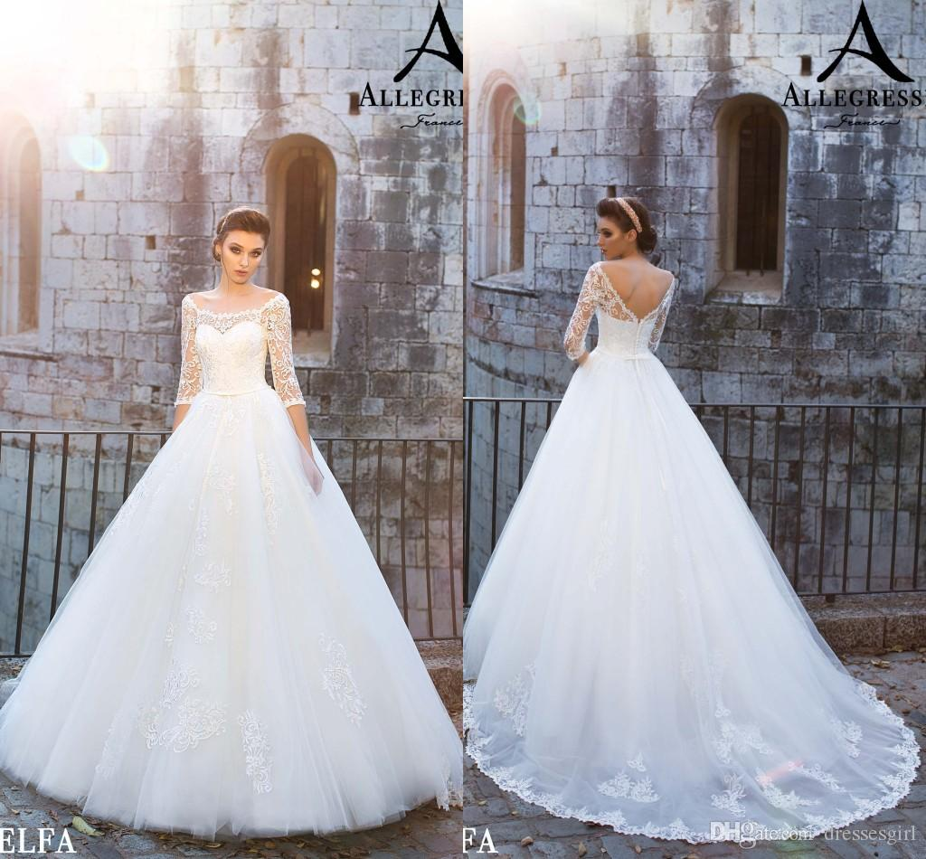 Discount Vintage Lace A Line Wedding Dresses 2018 Three Quarter Sequined  Long Sleeves Sheer Neck Tulle Bridal Gowns With Zipper Back Dresses On Sale  Elegant ... 3cb98fb2c5e5
