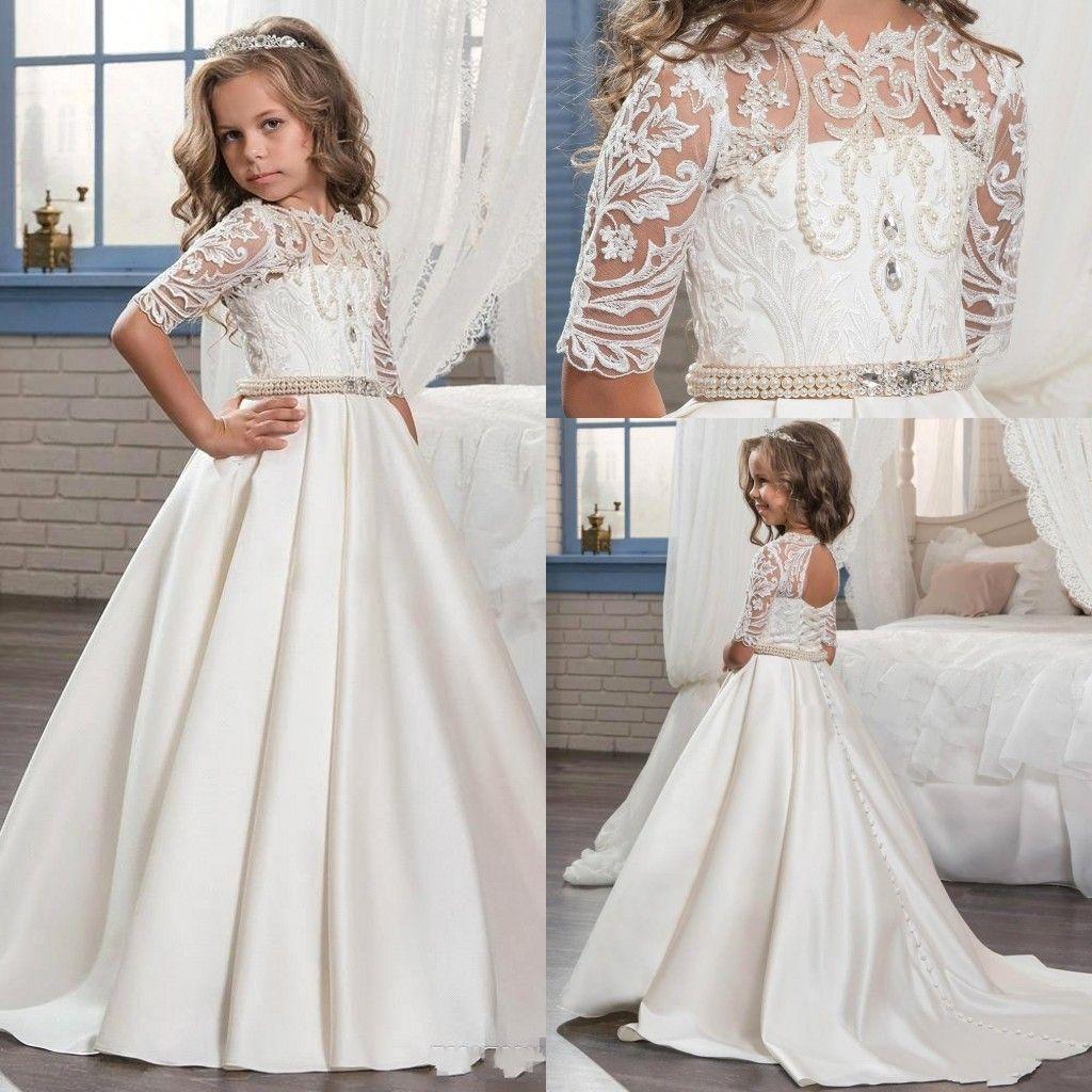 a6c818018 2018 Cute Princess Half Sleeve Holy Lace White Communion Dresses Little  Girls Beaded Pearls Party Kids Wedding Flower Girls Dresses BA7799  Christening ...