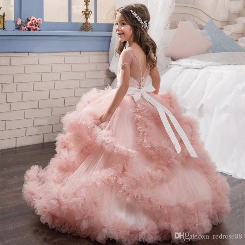 Blush Pink Girl Festzug Kleider 2018 New Sheer Juwel Hals mit Perlen Cascading Rüschen Einzigartiges Design Kind Glitz Pageant Kleider