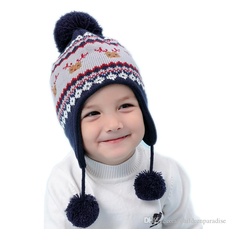 edd6cdfa472ec 2019 Baby   Kids Boys Geometric Print Reindeer Earflap Warm Fleece Knitted  Beanie Hat Children Winter Fashion Casual Hat Caps From Childrenparadise