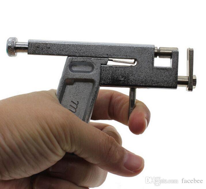 NEW Professional Ear Body Nose Piercing Gun Machine Tool Kit Set + Steel Studs Piercing the Ear Guns Iron Suit
