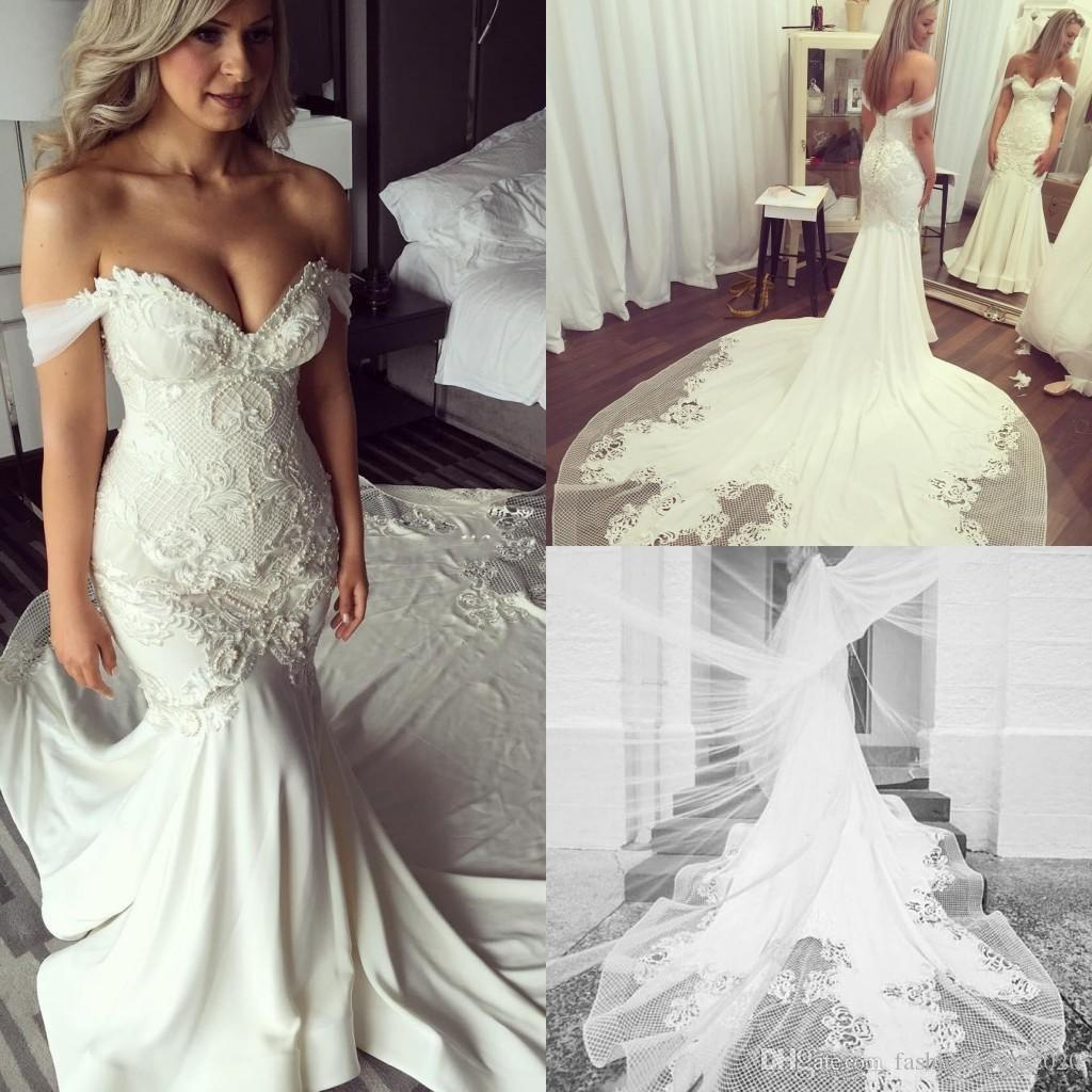 e5bc60318038 2018 Hot Luxury Mermaid Wedding Dresses Off The Shoulder Lace Appliques  Crystal Beaded Backless Chapel Train Custom Plus Size Bridal Gowns Wedding  Dresses ...