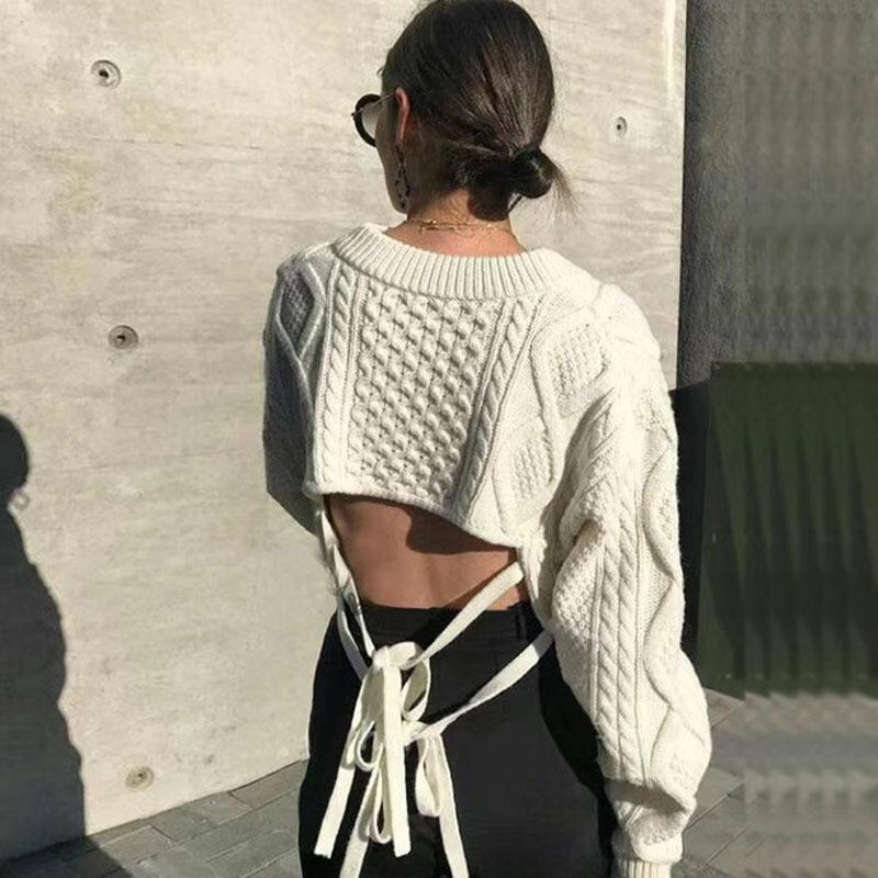 910d7ad4d1 2019 Women Wool V Neck Knit Crocheted Short Sweater Back Hollow Out Lace Up  Long Sleeve Female Pullover Top C18111501 From Linmei0004