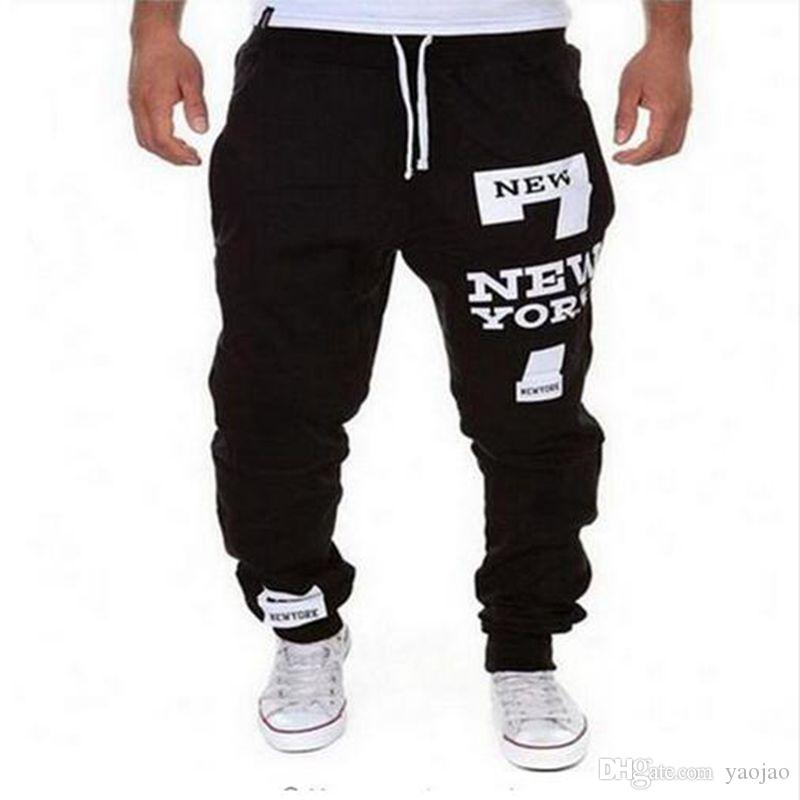 f8bac10a587f8 Compre Al Por Mayor Moda Biker Joggers Slim Fit Skinny Sweatpants Harem  Pants Hombres Hip Hop Swag Ropa Ropa Calle Alta Gris Negro Kanye West A   18.45 Del ...