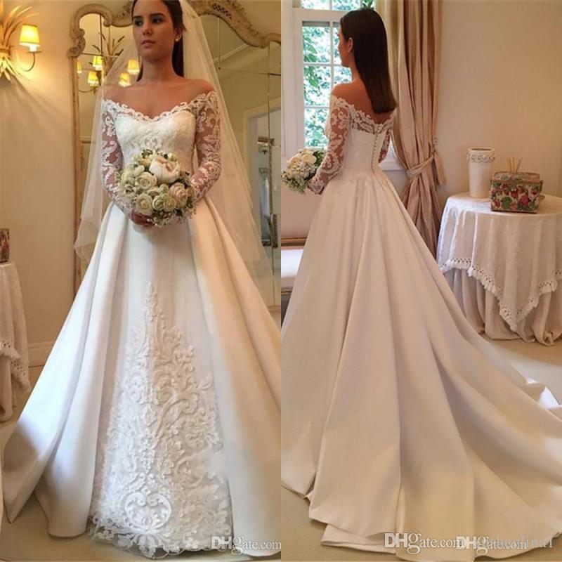 Acquista Abito Da Sposa Elegante Con Spalle Scoperte Abito Da Sposa Con  Maniche Lunghe In Pizzo Ricamato Abiti Da Sposa Affascinante Abito Da Sposa  In Raso ... 6802fd8d3a9
