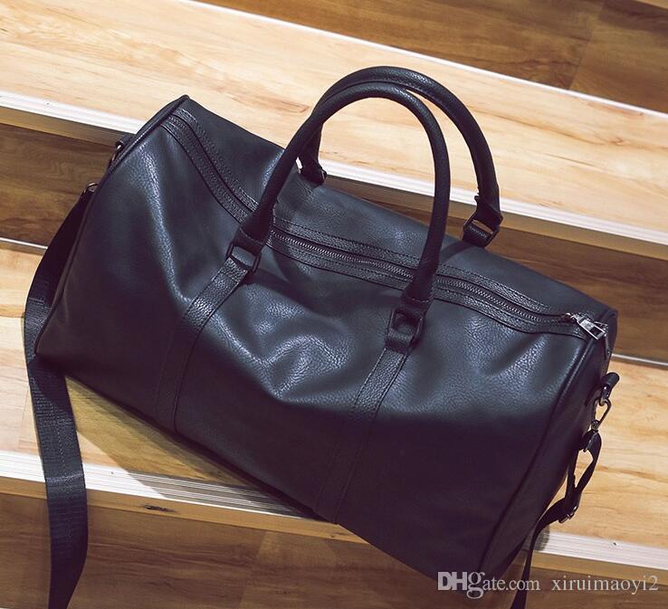 60CM grande capacité femmes sacs de voyage classiques vente chaude hommes de haute qualité épaule sacs polochons portent sur les bagages