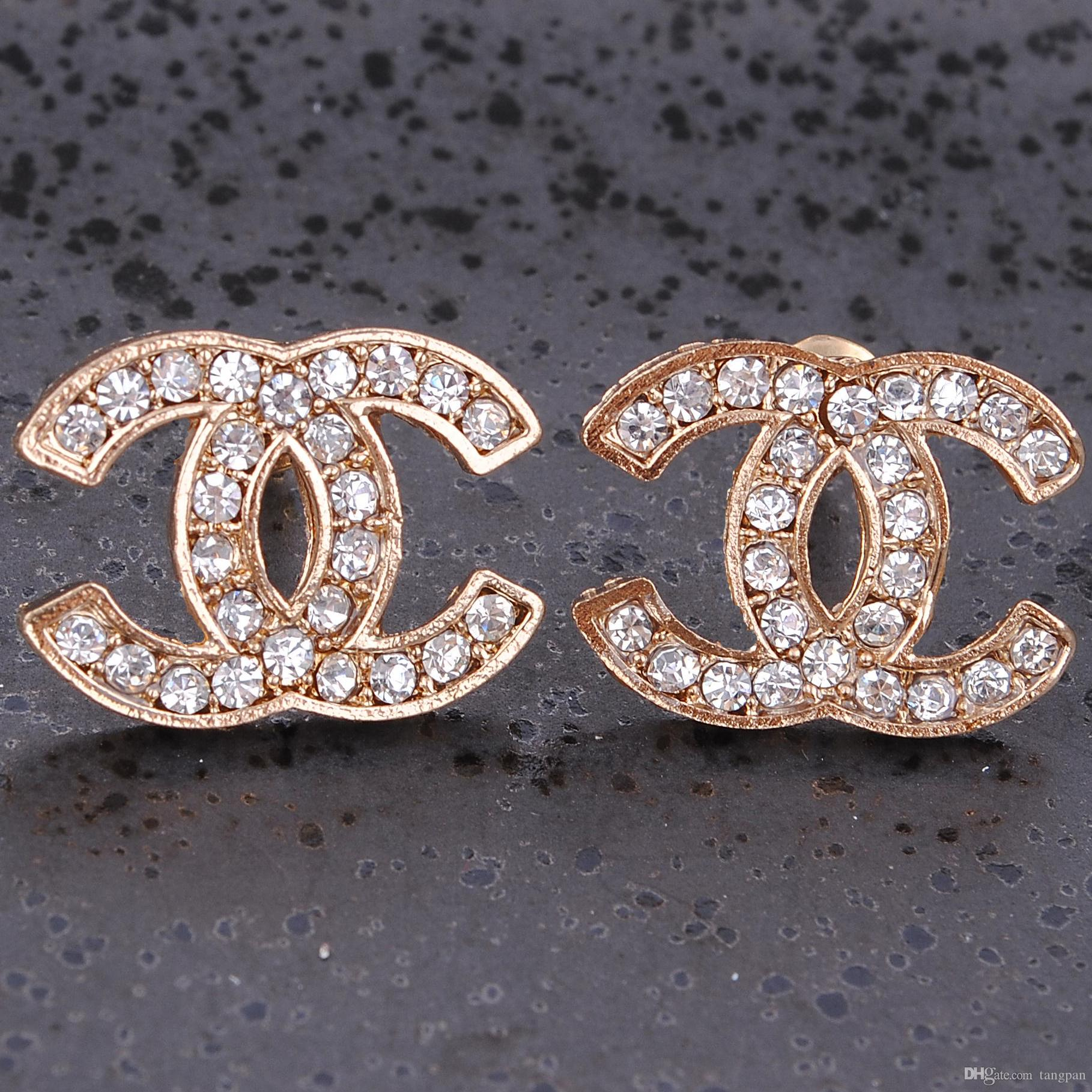 studded with and design cz earrings fashionable gold designer pin polish synthetic zircon stud stones