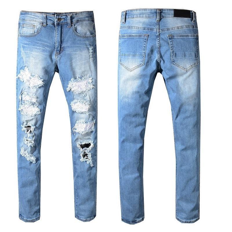 26ae2e337e44 Compre Estilo De Nueva Italia # 549 # Pantalones Desgastados Por El Hombre  Desgastados Cristales Parches Pantalones Vaqueros Pitillo Azules Delgados  ...