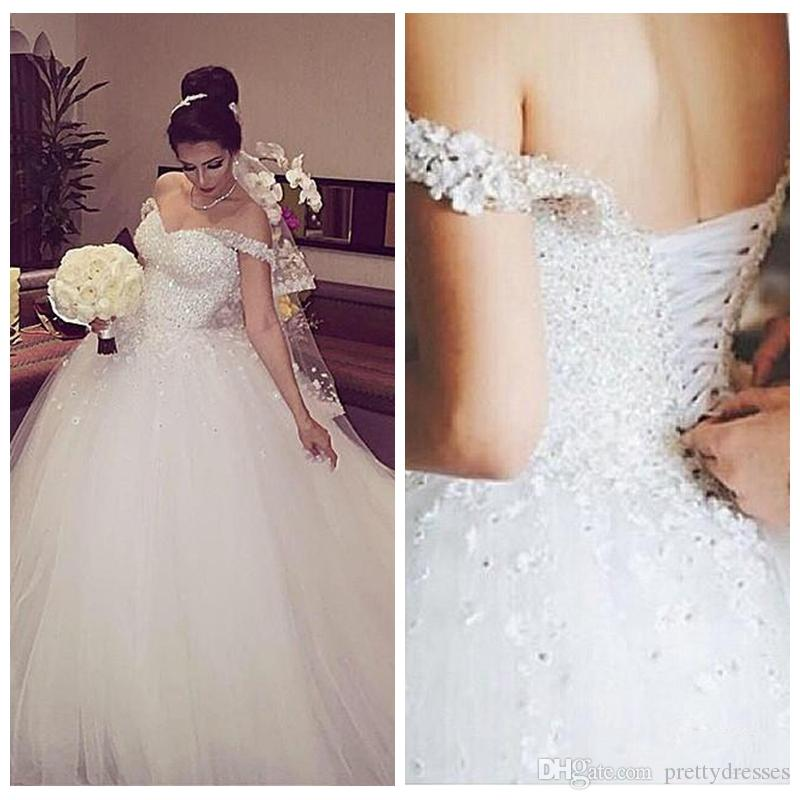 9dbe83b739e 2018 Off Shoulder Sparkly White Ball Gown Wedding Dresses Formal Beaded  Sequins 3D Flowers Adorned Lace Up Back Church Bridal Gowns Puffy Celebrity  Wedding ...