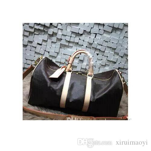 c71db4d769df Hot Luxury Brand Men Women Travel Bag PU Leather Duffle Bag Brand Designer Luggage  Handbags Large Capacity Sports Bag Beach Bags Laptop Backpack From ...