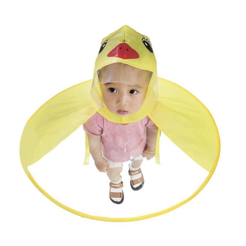 531a988215cca Children Raincoat Umbrella Cute Yellow Duck UFO Shape Rain Hat Cape Baby  Body Cover Creative Kids Raincoat Cap S3 Rainsuits For Kids Rain Coat Baby  From ...