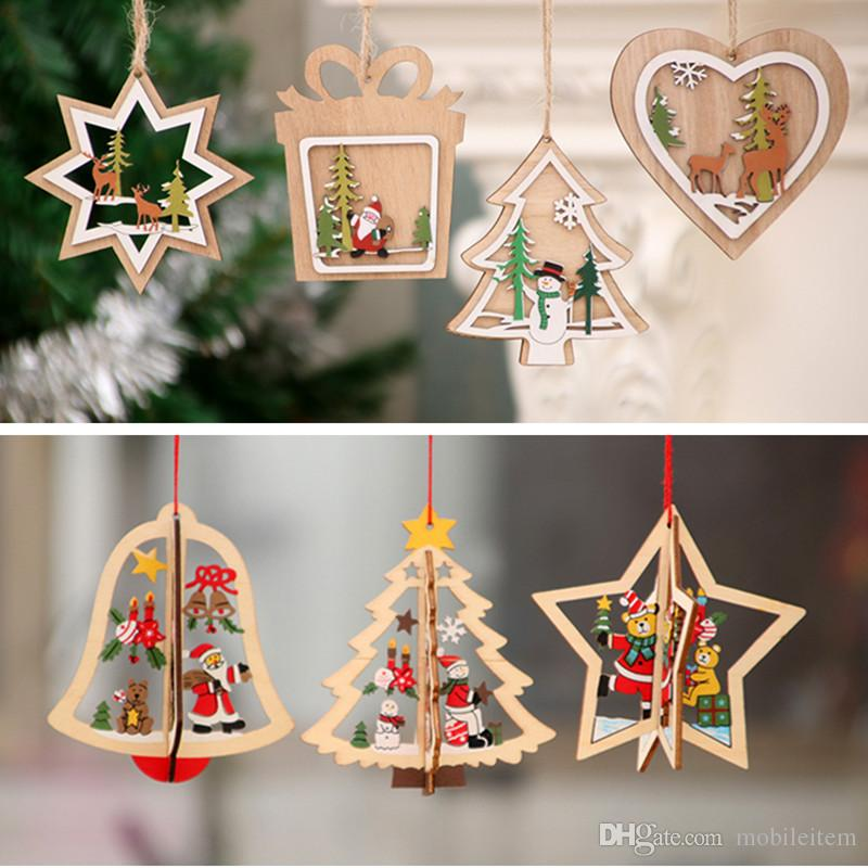 2018 wholesale christmas decorations wooden santa snowman hollowed christmas tree small pendant wooden five pointed star bell pendant gift 2307 from
