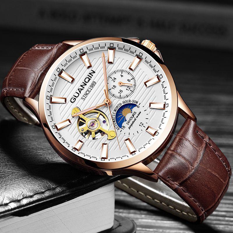 fa33bb47297 Compre Guanqin 2018 Homens Relógio Moda Relógio Automático Luminoso Homens  Esqueleto Tourbillon Estilo À Prova D  água Mecânica Relogio Masculino De  ...