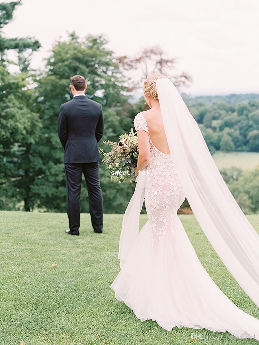 2018 Classic Sheer Jewel Wedding Dresses Short Sleeve Sexy Backless Appliques Lace Bohemian Garden Outdoor Mermaid Bridal Gown Custom Made